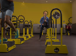 Woman Doing Step Ups In A Planet Fitness 30 Minute Circuit
