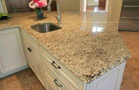 image of venetian gold granite kitchen countertops with white cabinets