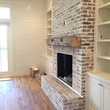 living room builtins fireplace chunky beamed mantle love the white washed brick