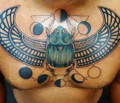 изображение скарабея на груди парня фото рисунки эскизы