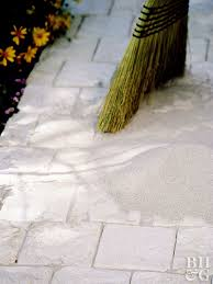 step 7 fill in with fine sand sweeping stone walkway