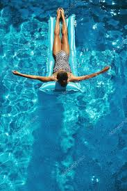 pool water with float. Woman Sunbathing, Floating In Swimming Pool Water \u2014 Stock Photo With Float A
