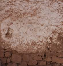 worn mud brick wall tagged ancient