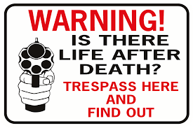 warning is there life after death trespass here out handgun  warning is there life after death trespass here out handgun