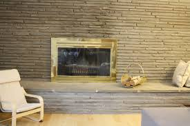 that particular gold fireplace front looked out of place against the flagstone wall and we ve been thinking a lot about replacement options
