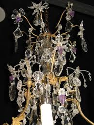 french crystal chandelier with delicate bronze frame with leaves an array of crystal beads