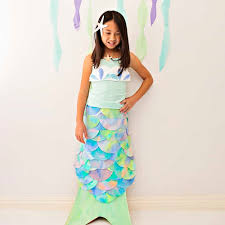 are your kids big mermaid fans let your under the sea princess shine with this beautiful diy mermaid costume made out of coffee filters