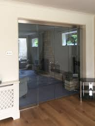 frameless glass sliding doors two doors sliding over fixed panels with round flush handles