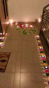 diy diwali rangoli design using a paper cut out and poster colours
