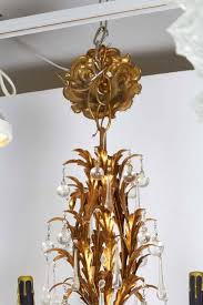 a luxurious tole chandelier in the hollywood regency style with eight arms each with