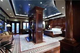 master bedroom interior design an absolutely stunning master bedroom in polished hardwood a center fireplace is dual sided master bedroom interior design