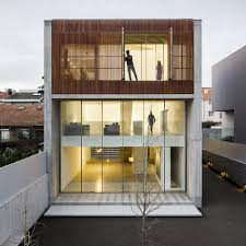 Wooden screens mask glazed walls of house by AZO Sequeira