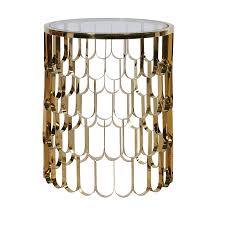 round glossy side table in gold