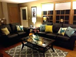 brown couch with navy blue pillows leather sofa rug dark on sectional bedrooms good looking pillow