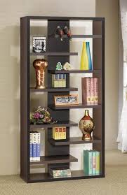 This is a staggered dark brown modern cube-style vertical bookshelf that  creates a pleasing