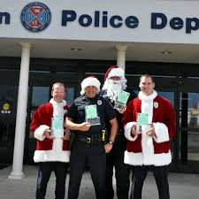 yukon police department spreads christmas cheer christmas the yukon police department is hoping to make some holiday s brighter this year s christmas a cop program which takes place on saturday