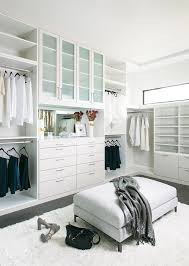 this closet features drawers for socks and underwear with plenty of eye level open shelving for shoes more shelving behind the glass doors can be used for