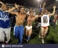 Velez Sarsfield's player Lucas Castroman (2nd R) celebrates with fans after  his team beat Estudiantes during the Argentine tournament, Buenos Aires,  June 26, 2005. Velez Sarsfield won the First Division Closing Argentine