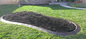 Concrete curbing is more economical and durable than traditional plastic  edging that tends to protrude and be cut off or damaged by lawn mowers.