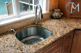 santa cecilias consistent pattern looks great in this simple and functional sink area for the home