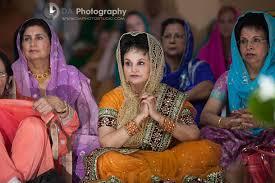 sikh gurdwara wedding ceremony groom s mother indian wedding photographer