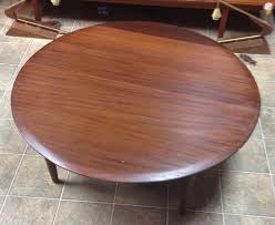 the glossy finish will need to be stripped away i have taken that into account when this piece the table measures 38 ½ inches in diameter