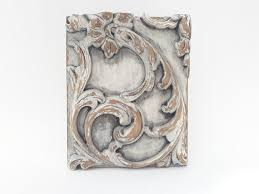 white washed wood panel carved wood
