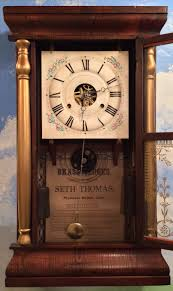 the dial seen below is correct for this clock though found separately on it had a lot of flaking paint seen on many older seth thomas zinc dials