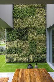 green wall- Villa Cascais in Lisbon, Portugal architecture by Frederico  Valsassina Arquitectos, garden by Vertical Garden design