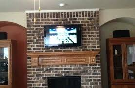 installing tv over fireplace hanging electric install tv mount on brick fireplace image collections norahbent