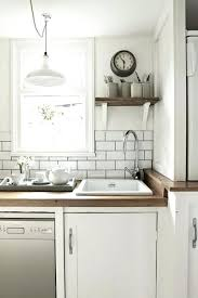 white tile for kitchen white tile with grey grout photos white tile kitchen counters black and