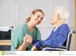 Geriatric Nursing Geriatric Nurse Holding Hands With Senior Woman Stock Image