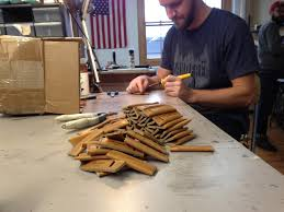 leather works minnesota employee joe madsen puts the finishing touches on leather toothpick holders