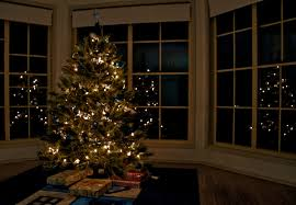 A Woman Decorates A Small Christmas Tree In A House Stock Footage Christmas Tree In Window