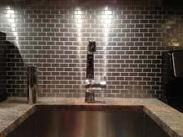 kitchen backsplash stainless steel tiles: our customers have done many different things with our stainless steel tile but the two most popular uses for it are on the kitchen backsplash