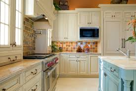 A Country Kitchen With A Light Blue Island And Multicolored Ceramic Tiles For The Backsplash