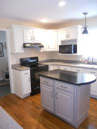 a photo of the finished kitchen the wall cabinets are in the beachside cottage finish