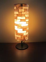 Best And Favorable Unusual Table Lamp Design In Tube Style Golden Light On  Wooden Table