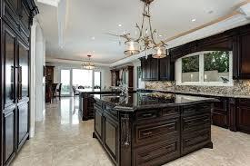 dark countertops with dark cabinets luxury traditional kitchen with dark raised panel cabinets dark marble counter island and light black granite