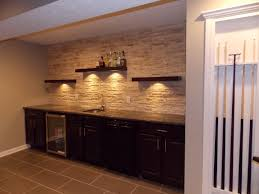 basement bar stone. CMH Builders Wet Bar With Floating Shelves On Stacked Stone Wall Basement E