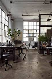 elle decoration office area a wheeled stool chair and two factory tables make for a flexible working space baya park company office design