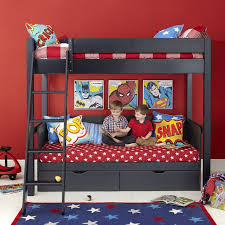 red room furniture. superhero themed black wooden aspace bunk bed with star pattern red bedding also two storage drawers and tilt style stairs for kids room furniture ideas