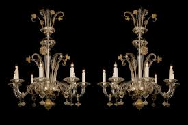 a fine pair of venetian clear glass and gilt decorated eight light chandeliers venice