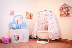 and then we have the doll bedroom and work space if you saw our original doll room set up you will notice we do tend to keep things arranged similarly
