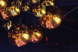 the party s decor included gold disco of various sizes