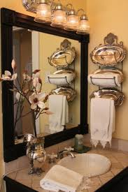 LOVE the towel holder and silver trays! DIY~ Add Molding & Wooden Square  Medallions To Your Plain Bathroom Mirror For A Designer Look.