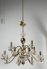 elegant twelve arm polished brass chandelier with glass bobeches the chandelier is accompanied with