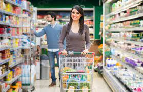 Woman shopping in a grocery store - stock photo   Crushpixel