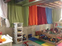 Brighten up an unfinished basement playroom with $4 twin flat sheets from  Walmart. Gather and