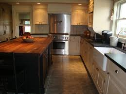 countertops dark wood kitchen islands table: kitchen black block kitchen island kitchen black block kitchen island with rectangle brown wooden top added by l shaped white wooden kitchen cabinet on ceramics flooring appealing butcher block kitchen island with cool design for your